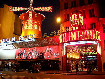 Moulin Rouge evening lighting Paris France